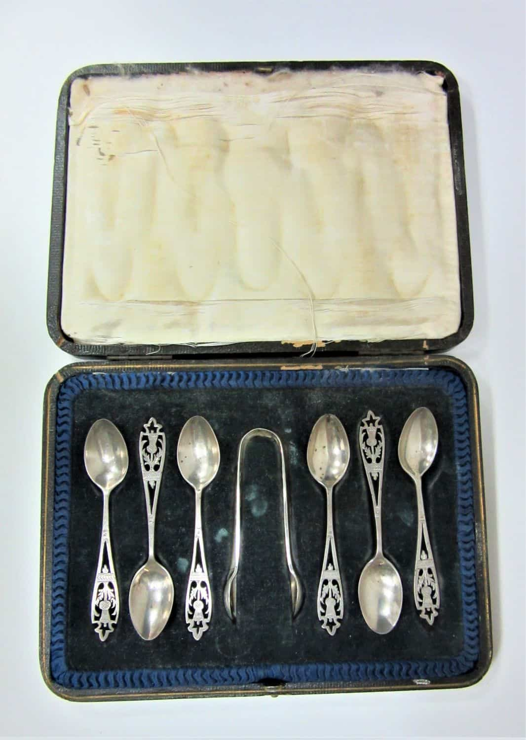 A set of silver teaspoons and sugar tongs decorated with thistles finely brightcut dated 1896 by cooper brothers and sons ,70GRAM