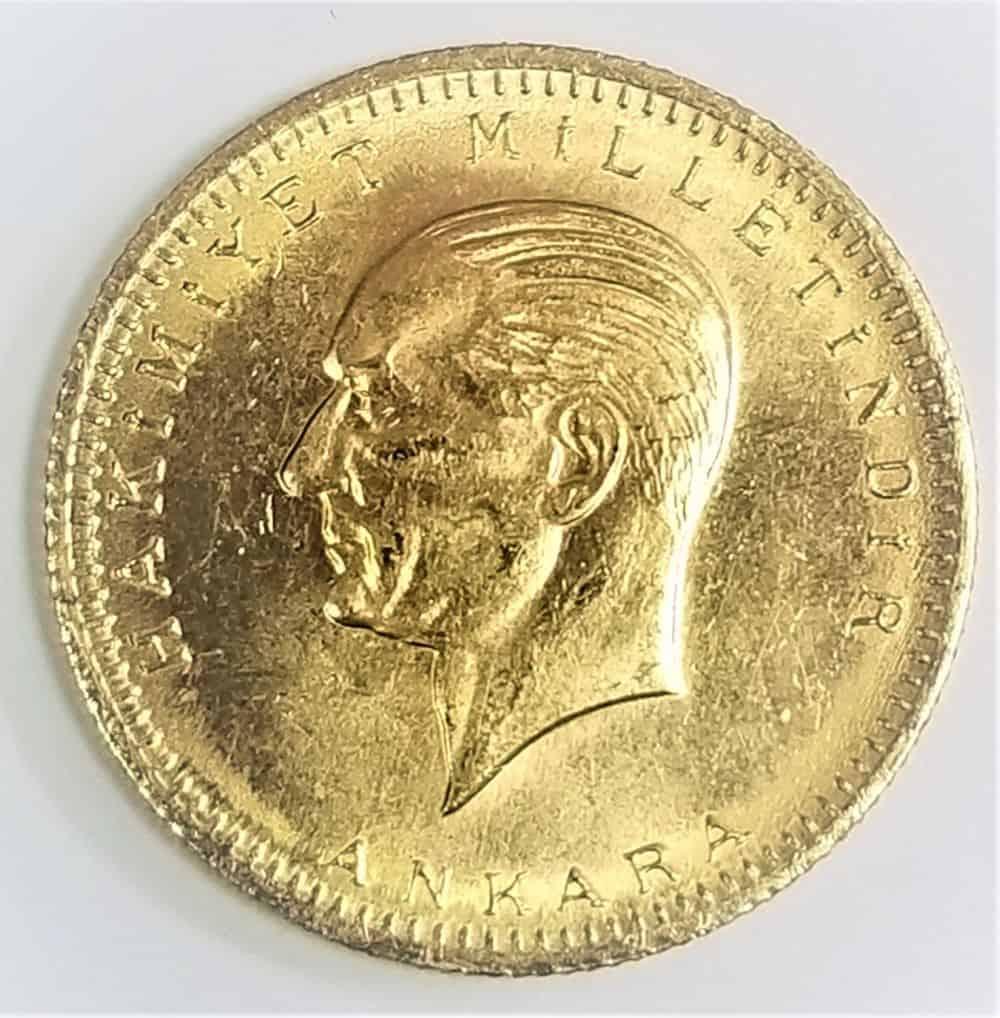 מטבע זהב בערך נקוב של 100 קורוש טורקי. טורקיה, 1923. זהב 917.(22קראט) משקל 7.23 גרם. מצב UNC.